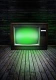 Fernsehen mit grünem Glühen Stockbild