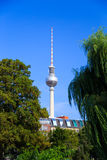 Fernsehturm Berlin. Fernsehturm in Berlin, Germany, seen from a park with lush trees Royalty Free Stock Photo
