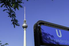 Fernsehturm with Berlin U Bahn Sign at Alexanderplatz. The Fernsehturm English: Television Tower is a television tower in central Berlin and U-Bahn system is a Royalty Free Stock Images