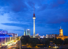 Fernsehturm television tower, Berlin views, Germany. Pretty night time illuminations of the iconic Fernsehturm television tower overlooking Berlin cityscape from Royalty Free Stock Image