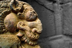 The ferocious stare. Side view of the ferocious stare of a mythological creature  taken at the temples of Bhubaneshwar in India Stock Image