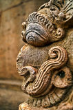 The ferocious stare. Side view of the ferocious stare of a mythological creature  taken at the temples of Bhubaneshwar in India Stock Photos