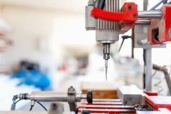 Ferramenta de perfuração na fábrica da produção, equipamento de fabricação Imagem de Stock Royalty Free