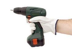 Ferramenta elétrica da chave de fenda na mão humana Fotografia de Stock Royalty Free