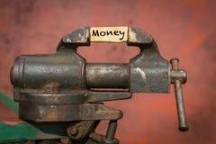Ferramenta vice com o dinheiro da palavra fotografia de stock