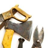 Ferramentas de funcionamento do vintage (machado, serra e outro) sobre Imagens de Stock Royalty Free
