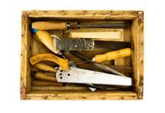 Ferramentas de funcionamento em uma caixa velha no fundo branco Foto de Stock Royalty Free