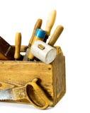Ferramentas de funcionamento em uma caixa velha no fundo branco Fotografia de Stock Royalty Free