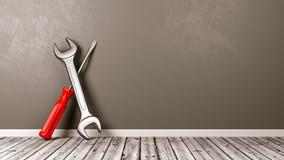 Ferramentas do trabalho no assoalho de madeira contra a parede Foto de Stock Royalty Free