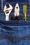 Ferramentas e calças de brim Imagens de Stock