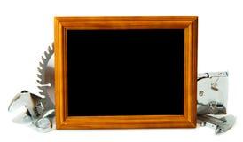 Ferramentas e quadro de funcionamento no fundo branco Imagens de Stock Royalty Free