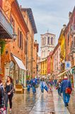 The walk in old Ferrara, Italy. FERRARA, ITALY - APRIL 30, 2013: The medieval curved streets in old town are the main shopping areas of the city, so beloved stock photo