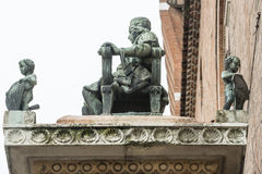 Ferrara (Italy). Ferrara (Emilia-Romagna, Italy): closeup of historic palace with column and statue on the top Stock Images