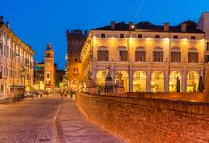 Ferrara, Italy: Evening view of the historic center of Ferrara. Illuminated old architecture and the city landmarks. Ferrara - July 2017, Italy: Evening view of Stock Images