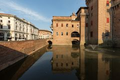 Castle Estense, a four towered fortress from the 14th century, Ferrara, Emilia-Romagna, Italy. Ferrara, Italy - June 10, 2017: Castle Estense, a four towered royalty free stock image