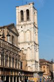 Scene of the Piazza Trento e Trieste and the cathedral tower, with local and tourists, in Ferrara, Emilia-Romagna, Italy stock photo