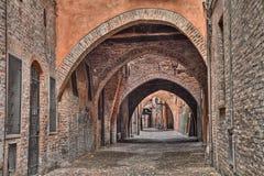 Ferrara, Italy: the medieval alley Via delle Volte Stock Images