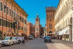 Ferrara, Italy: Central street of Ferrara. Taxi cabs and drivers near them stock photo