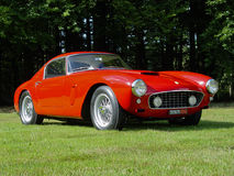 Ferrari 250 GT SWB in the sun. Ferrari 250 GT SWB parked on the grass in the sun Royalty Free Stock Photo