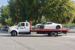 Ferrari 458 broken on tow truck Stock Image