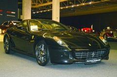 Ferrari color wet asphalt in the showroom Royalty Free Stock Image
