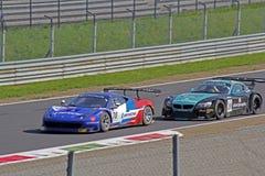 Ferrari contro il bmw Immagine Stock