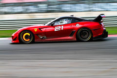 Red Ferrari race car on the track Royalty Free Stock Image