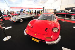Ferrari Dino 246 GT and Jaguar E-type classic cars on display during Singapore Yacht Show at One Degree 15 Marina Club Royalty Free Stock Photography
