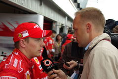 Ferrari driver interview Royalty Free Stock Images
