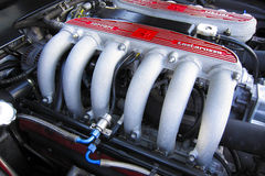 Ferrari engine manifold. Six lovely pipes which constitute half of a Ferrari V12 engine manifold Royalty Free Stock Image