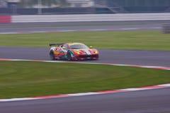 Ferrari 458 through the esses. Ferrari 458 GTE PRO Powers through the s bends at Silverstone 2014 stock photos