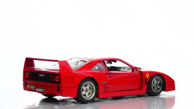 Ferrari F40 1980s supercar scale model. Car by BBurago rotating against a white background