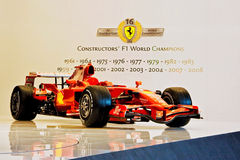 Ferrari F1 titles won. Bologna, Italy - December 4, 2008: Car model from Ferrari Formula 1, exposed during the Motorshow. On the wall are written the years when Royalty Free Stock Photo