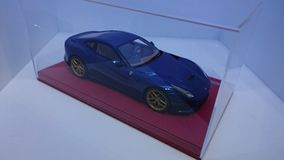 Ferrari F12 Berlinetta Tour de France edition model car in display stock photography