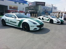 Ferrari FF and Lamborghini gallardo police car. Dubai Air Show Stock Photo