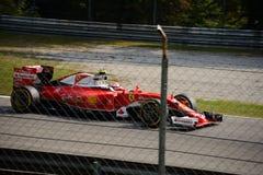 Ferrari formel 1 på Monza som är drivande vid Kimi Räikkönen Arkivbilder