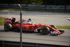 Ferrari Formula 1 at Monza driven by Sebastian Vettel. Scuderia Ferrari SF16-H during Friday free practice session of the 2016 Formula One Italian Grand Prix at Royalty Free Stock Photo