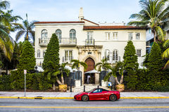 Ferrari in front of Versace mansion Royalty Free Stock Photo