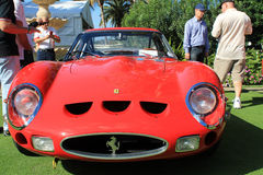 Ferrari gto racecar front view close up. Close up frontal view of classic 1960s ferrari gto racecar showing grill headlamps and air intakes and surrounded by stock photos