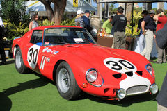 Ferrari gto racecar front view. Frontal view of iconic classic 1960s ferrari 250gto racecar showing grill, headlamps, racing decals, air intakes and surrounded stock images