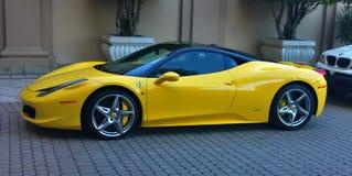 Ferrari Italia super vehicle. Yellow colored Ferrari Italia 458 super car parked near building Royalty Free Stock Photography