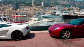 Ferrari And Lamborghini. Monaco-Ville, Monaco - June 22, 2017: Two Luxurious Italian Supercars Parked on Port Hercule: White Lamborghini Aventador LP700-4 and stock footage