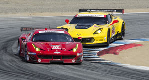 Ferrari leads Corvette Royalty Free Stock Images