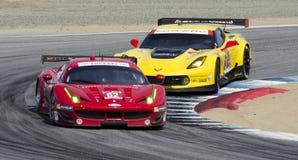 Ferrari leads Corvette Royalty Free Stock Images