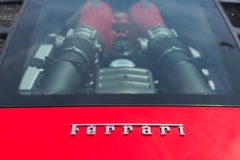 Ferrari logo and engine car on display Stock Images