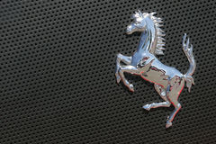 Ferrari logo on gray sport car