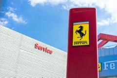 Ferrari logo. A Ferrari logo outside ferrari dealership Royalty Free Stock Image