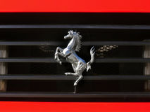 Ferrari Logo. On red sports car, Cavallino Rampante badge. Sign, symbol royalty free stock photography