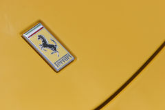 Ferrari logo on yellow sport car Stock Images