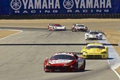 Ferrari que conduz em raças grandes do AM Rolex imagens de stock